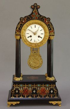 """""""Black enameled mantel clock decorated in the manner of Boulle with polychrome enamels and inlay of mother of pearl. Gilt bronze mountings and enamel dial. France, 19th century."""""""