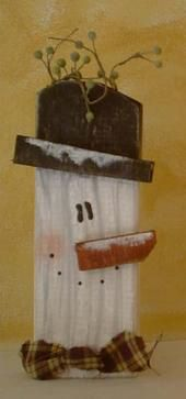 Snowman made with a 2x4.