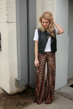 A LITTLE EDGE Add a little edge to your winter wardrobe with today's Black Leather Vest and Leopard Pants. This outfit will help you get in touch with your wild side…no matter where you decide to wear it. We paired a simple white tee underneath to really make the leopard on bottom pop! Shop this entire look today on www.shopriffraff.com.