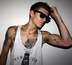 Love that small tattoo (bicep),I'd get the tattoo and want to keep the guy as well