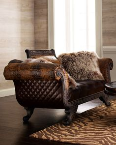 office statement piece!  Shaggy Leather Settee by Old Hickory Tannery at Neiman Marcus.