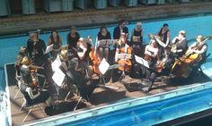 The West Yorkshire Symphony Orchestra performed Handel's Water Music in a swimming pool. How awesome is this???