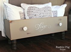 Old dresser drawer.  She added legs to create storage containers!  Love it!