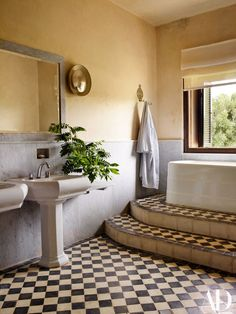 The master bath is outfitted with vintage fixtures, including a massive tub from the legendary La Mamounia Hotel in Marrakech.