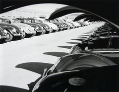PHOTOBOOK: VOLKSWAGEN - A WEEK AT THE FACTORY by Peter Keetman (1953) - One of the best-known and best-loved cars ever manufactured, the VW Bug was a symbol for decades of a casual lifestyle replete with breezy outings. But the 71 duotone photographs in this elegant paperbound volume offer a striking contrast to this populist impression. PHOTO: Lids up: the fuel filler was located in the front luggage compartment until September 1967
