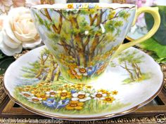 SHELLEY  TEA CUP AND SAUCER DAFFODIL TIME TEACUP YELLOW HANDLE