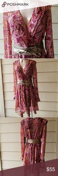 """M60 MISS SIXTY Paisley Long Sleeve Dress Sz 4 Lovely chic high and low paisley long sleeve  dress with cute brown wrap around belt. And zip at the back. It has pleats in front around the bust.  Length -36"""" Waist-14.5"""" Bust-16"""" Sleeve-26"""".  📍📌📬Add my closet to your favorite for new arrivals. I add new items to my closet every week .  ❌🚫No trading. ❌🚫 No lowballing ✔Offers through offer button only.  Reasonable offers please 💖 Miss Sixty Dresses Midi"""