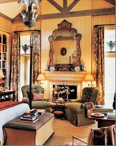 Imagine having a bedroom like this. Fireplace, bookshelves, beamed ceiling, warm colors. David Easton Design. Charming.