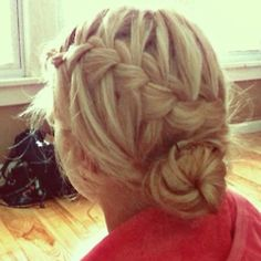 waterfall braid into a bun. very cute for summer!