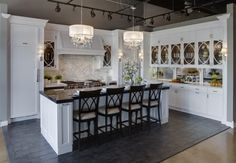 The backsplash is Calcutta Gold marble slabs with a chair rail frame and Ann Sacks BeauMonde tile in the center. The pattern is called Grace and is all Calcutta Gold...
