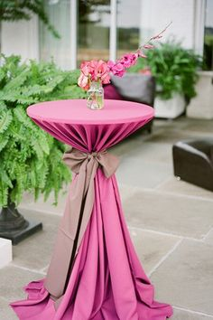 Tying black table cloths with big red ribbon! Add a golden centerpiece with red carnations and I'm in love.