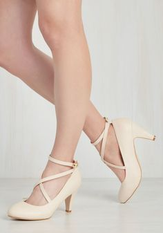 Snug as a Jitterbug Heel in Vanilla. Treat your dancing feet to something sweet each time you don these sleek ivory heels for a night on the town! #cream #modcloth