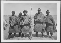 """Five Tibetan nomads of the Sokwo Arik tribe with amulets, swords, and rifle with gun rest. From Vol. 6, dated May 8, 1926: """"We climb into the long valley in which is situated the encampment of our nomads who brought us here.... The tents are mostly Mongol for the tribe known as the Sokwo Arik, Arik being the clan name, were originally Mongol. The plain or valley on which we are encamped is called Mamo zhung."""" Excerpt from May 9, 1926: """"Joseph Rock - On Shadow"""