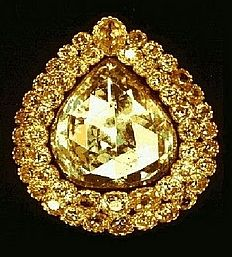 The Spoonmaker's Diamond, the pride of the Topkapi Palace Museum and its most valuable single exhibit as part of the Imperial Treasury, it is an 86 carats (17 g) pear-shaped diamond. Surrounded by a double row of 49 old mine-cut diamonds and well spotlighted, it hangs in a glass case on the wall of one of the rooms of the treasury. The surrounding separate brilliants give it the appearance of a full moon lighting a bright and shining sky amidst the stars.
