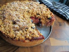 """Apple Blueberry Pie Cake """"They named it Apple Pie-Cake, but it's really a mammoth deep dish cinnamon apple pie baked in a shell of buttery brown sugar with crumbles of crunchy streusel on top."""""""