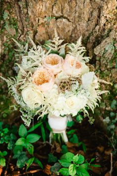 Incredible wedding bouquet with soft peonies and rustic scabiosa pods. Melinda Snyder Photography.