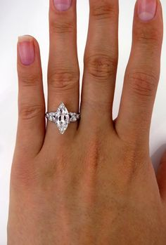 VIDEO: https://youtu.be/rqQtfnSUP-sThis rare and beautiful original Art Deco engagement ring, Circa 1920s. A very ELEGANT and CLASSY ESTATE old-cut vintage Marquise Diamond ring in PLATINUM .The  beautiful center stone, although weighing in at Shy 2ct ( 1.93ct ) ,  boasts the outer dimensions of a 3ct modern-cut marquise shape diamond.  The measurements are 14.26x6.24x3.50mm . The diamond has an Great cut  and proportions. Certified by GIA as H color and SI2 clarity, great  quality…
