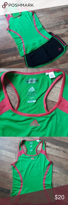 Adidas small running set Adidas size small running shorts lined skirts and unlined tank top.  Excellent condition - like new.    Bin #1 adidas Shorts Skorts