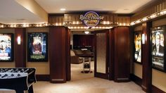 This ultimate rec room/home theater has the fun feel of hotel in Las Vegas.