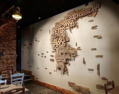 Sydney-based stu dio End of Work geographic wall decor. recently com pleted the identity and interiors for Meet the Greek, an Australian restaurant chain