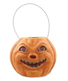 Vintage style paper mache Halloween Pumpkin Bucket with vellum eyes, mouth and nose.