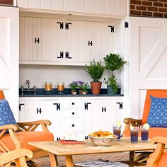 This rustic barn-inspired space has large doors that can protect the outdoor kitchen from bad weather. More outdoor storage solutions: http://www.bhg.com/home-improvement/porch/outdoor-rooms/outdoor-storage-solutions/?socsrc=bhgpin040813barninspiredpatio=3
