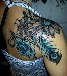 Flowers with Peacock Feather Shoulder Tattoo.
