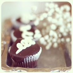 Ding Dong Cupcake!!  A chocolate cupcake filled with whip cream & crowned with chocolate ganache and chocolate ribbon.