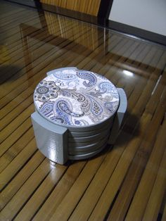 Love these paisley coasters! All she did was use old wooden coasters, mod podge & craft paper!