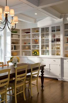 Like the style of the cabinets...simple.  Like the wood floor, dark table and painted dining chairs.  LOVE this look!!