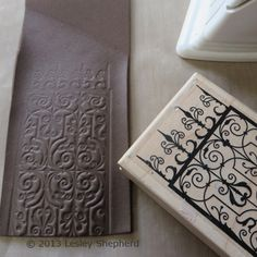 Craft foam has been heated between layers of a teflon pressing cloth, then stamped with a rubber stamp to create an embossed design on the foam.