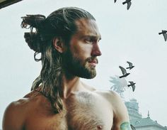 A hairstyle that defiantly breaks the dapper, vintage look of men--- the man bun. A man bun is Man Bun Haircut, Man Bun Hairstyles, Popular Mens Hairstyles, Man Bun Styles, Beard Styles, Moustache, Top Knot Men, Hipster Noir, Hipster Haircuts For Men