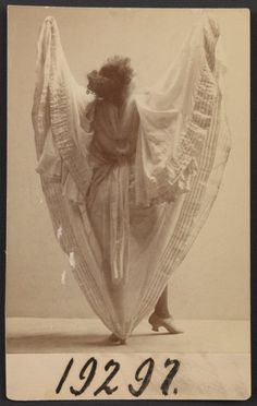 """Loie Fuller - """"Serpentine"""" dance., Digital ID 1990176, New York Public Library - LOVE her! Loie Fuller is the reason the typical stage is black with black curtains, she was a pioneer when it came to lighting and color!!!"""