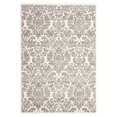 Anchor your living room seating group or define space in the den with this lovely rug, featuring a damask motif.  Product: Rug