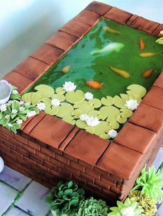 Fishpond I made this cake for a fairly new customer, this is her cake and she is the loveliest lady and always gives me such great themes to work with. This is for her aunt who is turning 80 and has a lovely big fish pond in her garden and loads of pot… Gorgeous Cakes, Pretty Cakes, Cute Cakes, Amazing Cakes, Amazing Art, Crazy Cakes, Fancy Cakes, Fondant Cakes, Cupcake Cakes