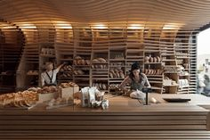 Baker D Chirico by March Studio  The design choice allows not only for natural storage and cutting board function, but at the same time presents a complimentary atmosphere for a baker. Imagine how good it smells in there.