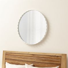 Scalloped edge surrounds mirrored circle in white steel for a fresh, contemporary look with a bright, light feel. Designed by Bethan Gray, who was recently named Best British Designer by the 2013 British Design Awards.