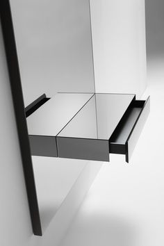 Console with a grey mirror, drawer and LED lights by Kendo Mobiliario _
