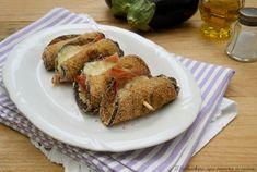 Gli involtini di melanzane al forno con speck e provola dolce sono un secondo piatto gustoso e saporito facilissimo da preparare.