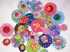 Fabric Applique Flower Yo-Yo Button Rosette Bead Hair Clip Bow Yo Quilt Fabric Scrapbook Applique Embellishment Trim Retro 64 Bright 1/2 Off. $9.50, via Etsy.