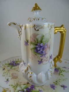 """The large tray measures about 17.25"""" from handle to handle and the teapot is 9.5"""" tall. All pieces have what looks like a Clematis purple flower design. Get Supersized Images & Free Image Hosting. 