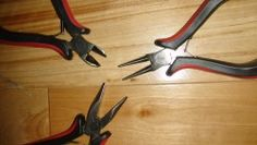 Close-up of nose - Left to right from top:  Cutter, Round-nose pliers, Chain-nose pliers.