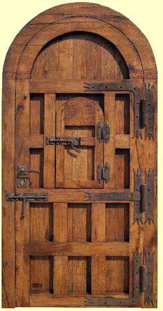 Vista trasera puerta rustica de madera 220x120x8 de roble con herrajes artesanales de forja de fragua