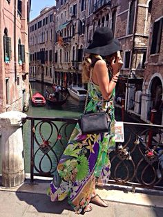 Venice....gorgeous maxi dress..love the pattern...the flat cute sandals,the mk purse..the hat....great idea of what to wear when you travel in Venice!