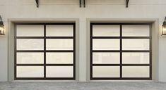 Aluminum garage doors give a home a distinct modern look.   http://www.wayne-dalton.com/residential/Pages/default.aspx