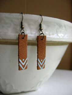 Brown and blue triangle tribal leather earrings hand painted by WhiteGooseEmporium on Etsy https://www.etsy.com/listing/201840202/brown-and-blue-triangle-tribal-leather