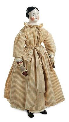 """Theriault's Antique Doll Auctions - Large German Porcelain Lady Doll with Brown Eyes - 29"""" (74 cm.) Pink-tinted porcelain shoulder head with rounded face,black sculpted hair in short uniform finger curls,brown painted eyes,red and black upper eyeliner,single stroke brows,accented nostrils,closed mouth,muslin stitch-jointed body. Condition: generally excellent. Germany,circa 1865."""