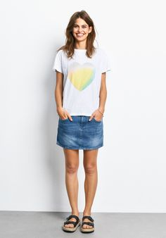"""This pretty tee with it's colourful heart in pastel shades will brighten up your everyday outfits. Pair with a denim mini and white plimsoles. •Loose fit. Try your usual size. •Pastel heart motif. •Slips on over the head. •Crew neck with short sleeves and centre back seam. •Sits below the hip. •Lightweight cotton. •Length 62cm (size S). •Model is 5'9"""" and wears size S."""