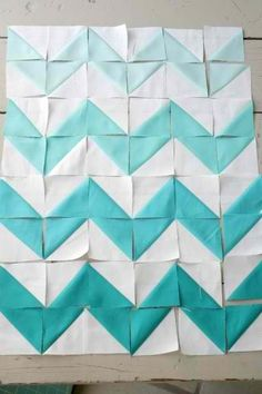DIY triangle chevron quilt. Ombré AND chevron...holy trend combo batman. I think I might like it......