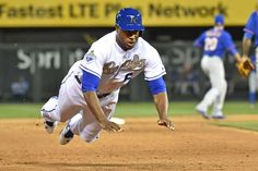 Hit the dirt:   Kansas City Royals center fielder Lorenzo Cain dives safely into third base after advancing on a single by Eric Hosmer against the New York Mets in Kansas City, Mo., on April 3.  -      © Peter G. Aiken/USA TODAY Sports
